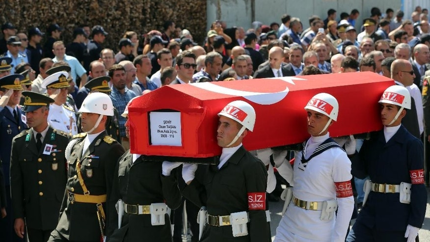 Turkish soldiers carry the coffin of Okan Tasan, a Turkish army officer killed in a Kurdish rebel attack, during a funeral ceremony at the Kocatepe Mosque in Ankara, Turkey, Thursday, Sept. 10, 2015.16 soldiers were killed and six others were wounded in a Kurdish rebel attack against troops in southeast Turkey on Sunday.(AP Photo/Burhan Ozbilici)