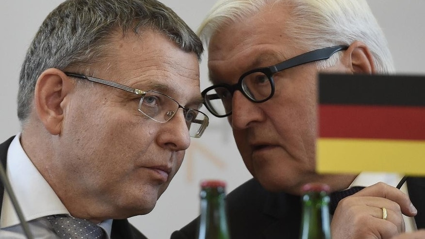Czech Foreign Minister Lubomir Zaoralek, left, and his German counterpart Frank-Walter Steinmeier talk during a press conference after a meeting of the Visegrad Group countries (Czech Republic, Slovak, Hungary, Poland), Germany and Luxembourg on migration in Prague on Friday, Sept. 11, 2015. ( Roman Vondrous/ CTK via AP) SLOVAKIA OUT