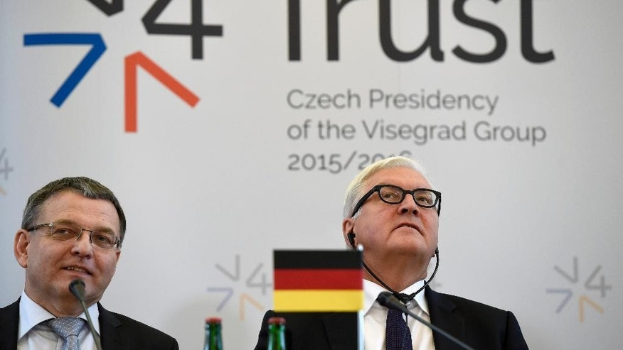 Czech Foreign Minister Lubomir Zaoralek, left, answers a question as his German counterpart Frank-Walter Steinmeier listens during a press conference after a meeting of the Visegrad Group countries (Czech Republic, Slovakia , Hungary,   Poland), Germany and Luxembourg on migration in Prague on Friday, Sept. 11, 2015. (Roman Vandrous/ CTK via AP) SLOVAKIA OUT