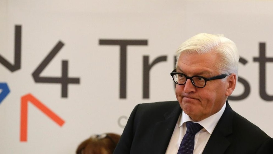 Germany's Minister of foreign affairs Frank-Walter Steinmeier grimaces during a press conference as the Visegrad Group foreign ministers meet their counterparts from Germany and Luxembourg to talk about the  current migration crisis in Prague, Czech Republic, Friday, Sept. 11, 2015. (AP Photo/Petr David Josek)