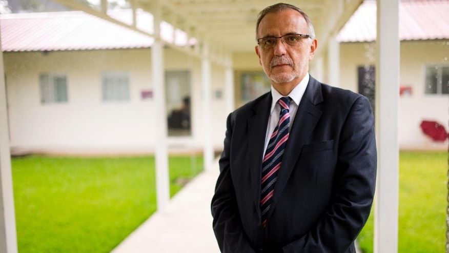 In this Aug. 31, 2015 photo, Commissioner of the United Nations International Commission Against Impunity, Ivan Velasquez, poses for photos during an interview at the commission headquarters in Guatemala City. As head of the International Commission Against Impunity in Guatemala, CICIG for its Spanish initials, he has taken the biggest swipe at entrenched corruption in the small Central American country, and landed former President Otto Perez Molina in jail on graft charges. (AP Photo/Moises Castillo)