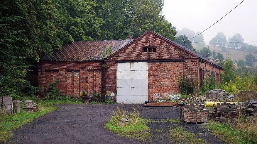 The abandoned building of a German nazi-era railway installation in Walim, near Walbrzych, in Poland, photographed  on Friday, Sept. 11, 2015.  An explorer says he has found massive underground World War II installations in the neighborhood that were probably intended as a anti-nuclear shelter for Hitler. (AP Photo)  Poland Out