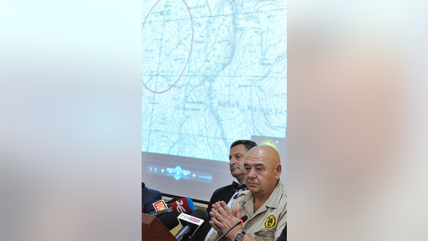 Explorer Krzysztof Szpakowski, right, with his legal advisor,attends a news conference  at the provincial governor's office in Walbrzych, Poland on Friday, Sept. 11, 2015.  Szpakowski   claimed Friday he has found a massive underground structure in southwestern Poland that, he says, the Nazis built to protect thousands of people.   (AP Photo)  Poland Out