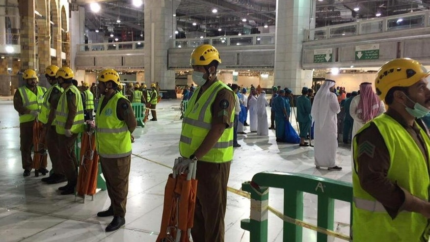 In this image released by the Saudi Interior Ministry's General Directorate of Civil Defense, an area is cordoned off at the Grand Mosque in Mecca after a crane collapsed killing dozens, Friday, Sept. 11, 2015. The accident happened as pilgrims from around the world converged on the city, Islam's holiest site, for the annual Hajj pilgrimage, which takes place this month. (Saudi Interior Ministry General Directorate of Civil Defense via AP)