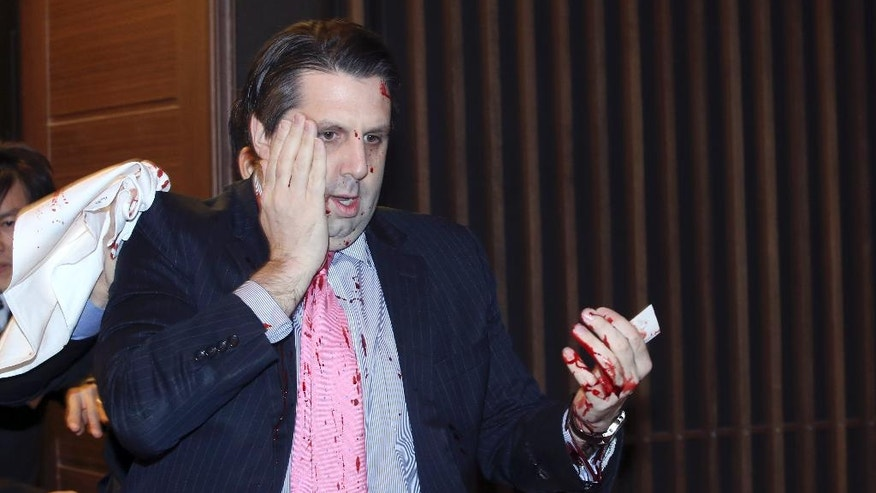 U.S. Ambassador to South Korea Mark Lippert leaves a lecture hall for a hospital in Seoul, South Korea, Thursday, March 5, 2015. U.S. Ambassador Mark Lippert was slashed on the face and wrist by a man wielding a blade and screaming that the rival Koreas should be unified, South Korean police said Thursday. (AP Photo/Yonhap, Kim Ju-Sung) KOREA OUT