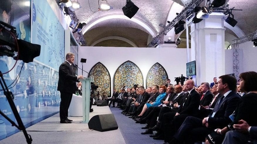 """Ukrainian President Petro Poroshenko, left, speaking during the 12th  Annual Meeting entitled """"At Risk: How New Ukraine's Fate Affects Europe and the World"""" organized by the Yalta European Strategy (YES) in partnership with the Victor Pinchuk Foundation at the Mystetsky Arsenal Art Center in Kiev, Ukraine, Friday, Sept. 11, 2015. More than 200 leaders from politics, business and society representing more than 20 countries will discuss major global challenges and their impact on Europe, Ukraine and the world. (AP Photo/Efrem Lukatsky)"""