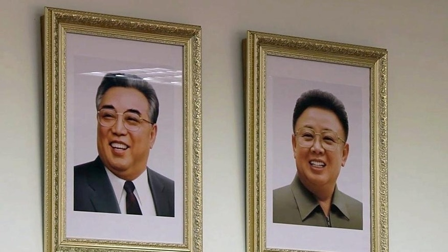In this image made from video taken Wednesday, Sept. 9, 2015, portraits of former North Korean leaders Kim Jong-il, right, and Kim Il-sung, hang on a wall in a class where children from North Korea and Russia study together in Khabarovsk, Russia's Far East. The class, with seven students from North Korea, is taking part in a new program in the city of Khabarovsk that aims to promote cultural understanding between the neighboring countries. (AP Photo)