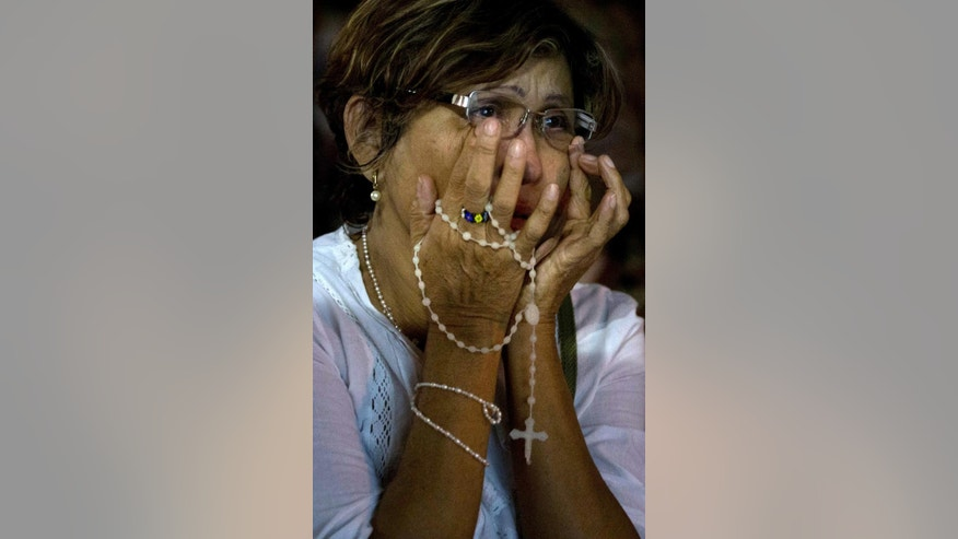 A Supporter of opposition leader Leopoldo Lopez cries as she listens to Lopez's guilty verdict at Bolivar square, in Chacao, Caracas, Venezuela, Thursday, Sept. 10, 2015. Lopez has been found guilty of inciting violence for his role as leader of a sometimes bloody protest movement in 2014, and was sentenced to almost 14 years in prison. (AP Photo/Fernando Llano)