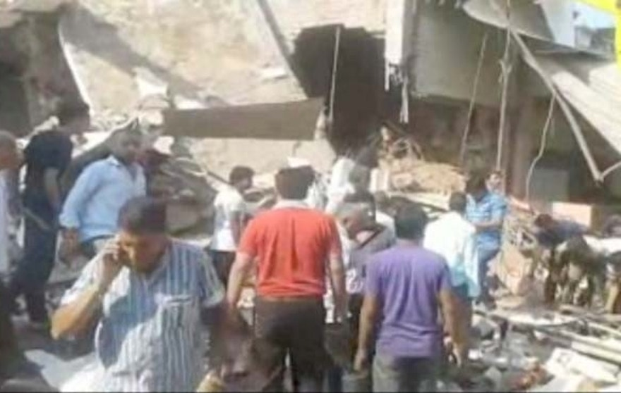 Sept. 12: In this frame grab from video, people help at the scene after an explosion at a restaurant in Petlawad, India.
