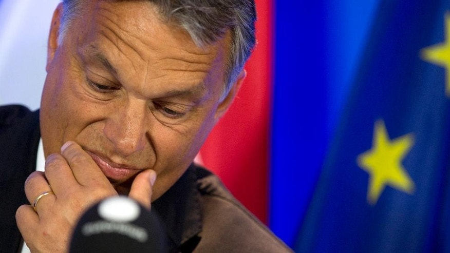 FILE - In this Thursday, Sept. 3, 2015 file photo, Hungarian Prime Minister Viktor Orban pauses before speaking during a media conference at the EU Council building in Brussels. The Baltic countries, as well as Hungary, Poland, Slovakia and the Czech Republic, have all rejected mandatory refugee quotas, often with the argument that they don't want their relatively homogenous societies to become multicultural. EU officials and human rights groups say they've been disappointed by the animosity toward asylum-seekers in countries from which hundreds of thousands of people fled communist dictatorships just decades ago. Viktor Orban's government is refusing to accept a single refugee under the EU plans and resisting their attempts to cross the country to reach more welcoming countries like Germany and Sweden. Slovakia has offered to accept 200 people - as long as most of them are Christians. (AP Photo/Virginia Mayo, file)