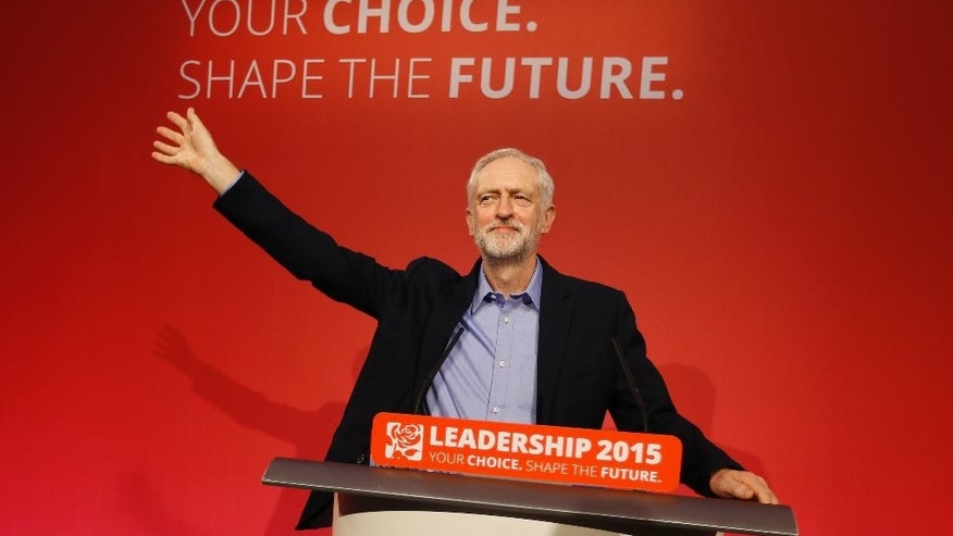 Jeremy Corbyn waves on stage after being elected the new leader of The Labour Party in London, Saturday, Sept. 12, 2015.