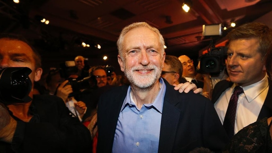 Jeremy Corbyn smiles as he leaves the stage  after he is announced as the new leader of The Labour Party during the Labour Party Leadership Conference in London, Saturday, Sept. 12, 2015. Corbyn will now lead Britain's main opposition party. (AP Photo/Kirsty Wigglesworth)