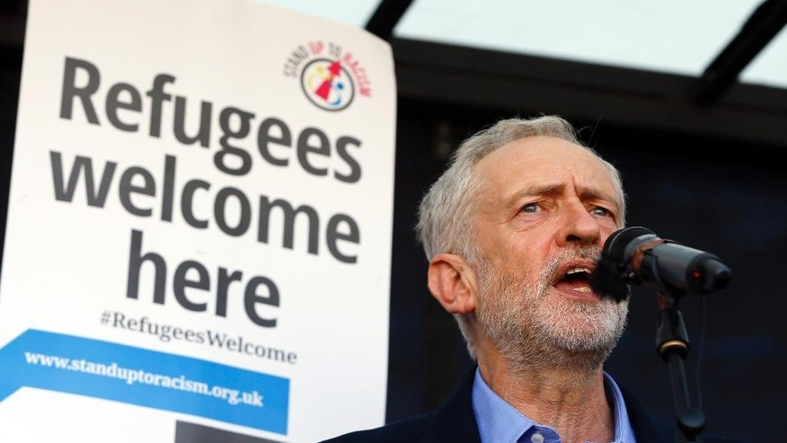 Jeremy Corbyn, the newly elected leader of Britain's opposition Labour Party, gives a speech from a lorry at a Solidarity with Refugees march in Parliament in London, Saturday, Sept. 12, 2015. (AP Photo/Kirsty Wigglesworth)