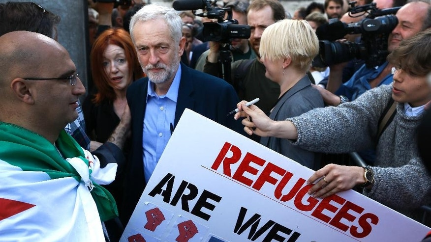 Jeremy Corbyn, the newly elected leader of Britain's opposition Labour Party, arrives to give a speech from a lorry at a Solidarity with Refugees march in Westminster in London, Saturday, Sept. 12, 2015. (AP Photo/Kirsty Wigglesworth)