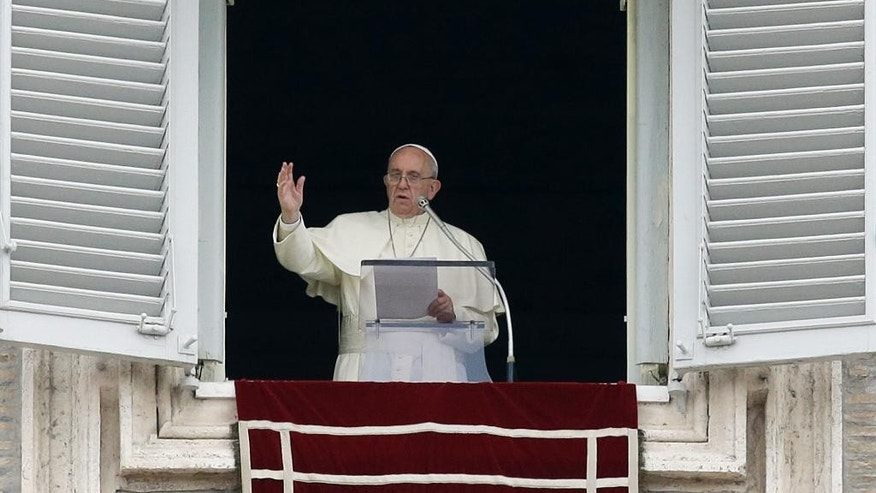 Pope Francis delivers a blessing from his studio's window overlooking St. Peter's Square on the occasion of the Angelus noon prayer at the Vatican, Sunday, Sept. 13, 2015. (AP Photo/Gregorio Borgia)