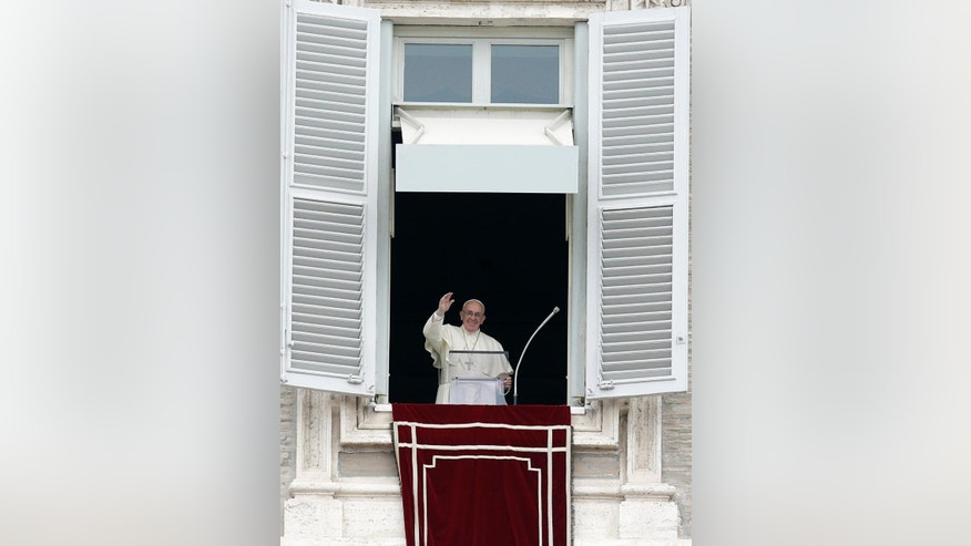 Pope Francis waves to faithful from his studio's window overlooking St. Peter's Square on the occasion of the Angelus noon prayer at the Vatican, Sunday, Sept. 13, 2015. (AP Photo/Gregorio Borgia)