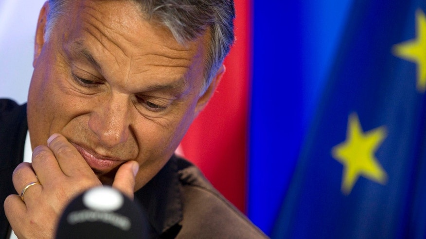 ILE - In this Thursday, Sept. 3, 2015 file photo, Hungarian Prime Minister Viktor Orban pauses before speaking during a media conference at the EU Council building in Brussels.