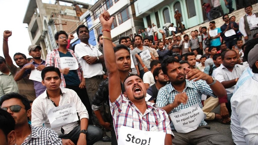 Activists of the Madhesi group participate in a protest near the Constituent Assembly Hall in Kathmandu, Nepal, Sunday, Sept. 13, 2015. Nepal's Constituent Assembly has begun voting on a draft of the Himalayan nation's much-delayed new constitution despite protests from ethnic minority groups. (AP Photo/Niranjan Shrestha)