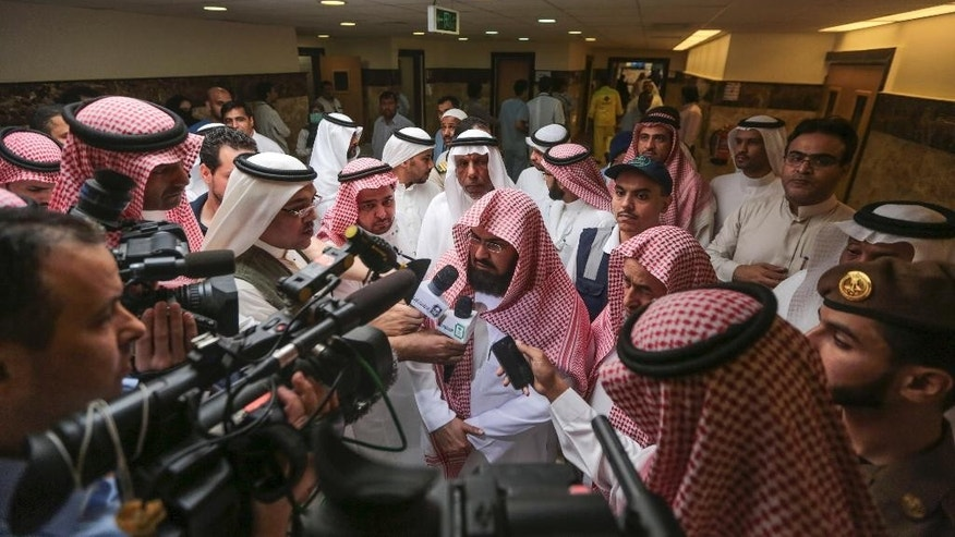 Abdul Rahman Al Sudais, Imam of the Grand Mosque in Mecca, speaks to the media after visiting victims of Friday's crane accident at the mosque being treated at Al-Noor specialist hospital in Mecca, Saudi Arabia, Sunday, Sept. 13, 2015. High winds were to blame for the toppling of a massive crane that smashed into the mosque and killed over 100 people ahead of the start of the annual hajj pilgrimage, the head of Saudi Arabia's civil defense directorate said Saturday. (AP Photo/Mosa'ab Elshamy)