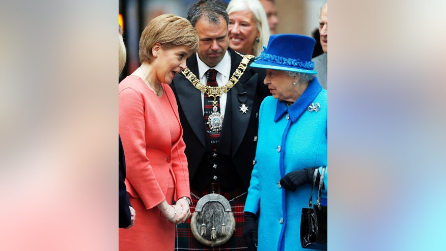 Britain's Queen Elizabeth II meets First Minister of Scotland Nicola Sturgeon, left, as she arrives at the opening ceremony for the Borders Railway route at Tweedbank station, Scotland, Wednesday Sept. 9, 2015.  The Queen has today become the longest ever reigning monarch in British history surpassing Queen Victoria who served for 63 years and seven months.  Danny Lawson  / PA via AP) UNITED KINGDOM OUT - NO SALES - NO ARCHIVES