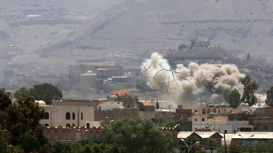 Debris and smoke rise after a Saudi-led airstrike hits an army base in Sanaa, Yemen, Saturday, Sept. 12, 2015. Yemen has been torn by a ferocious war pitting rebels, known as Houthis, and forces fighting for former President Ali Abdullah Saleh against fighters loyal to exiled President Abed Rabbo Mansour Hadi, as well as southern separatists, local militias and Sunni extremists. (AP Photo/Hani Mohammed)
