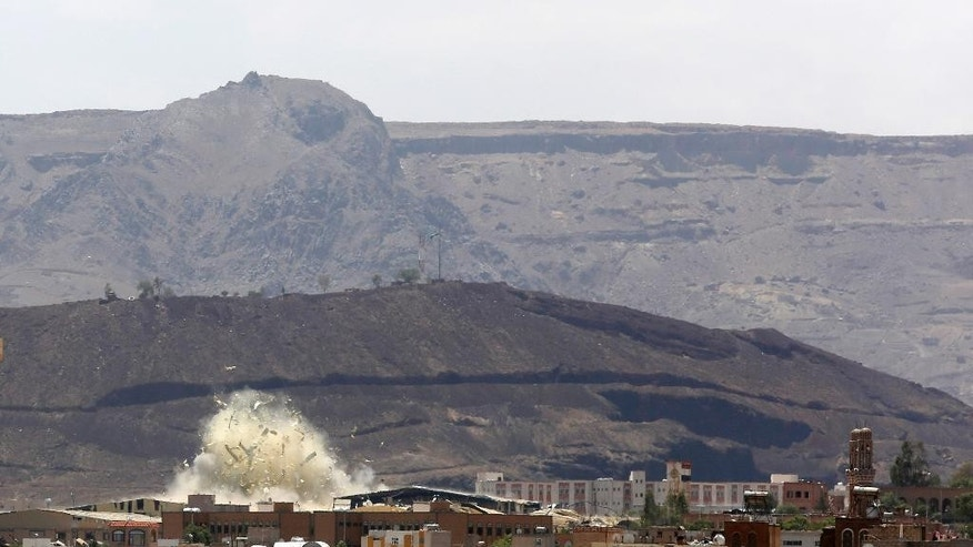 Debris and smoke rises after a Saudi-led airstrike hits an army base in Sanaa, Yemen, Saturday, Sept. 12, 2015. Yemen has been torn by a ferocious war pitting rebels, known as Houthis, and forces fighting for former President Ali Abdullah Saleh against fighters loyal to exiled President Abed Rabbo Mansour Hadi, as well as southern separatists, local militias and Sunni extremists. (AP Photo/Hani Mohammed)