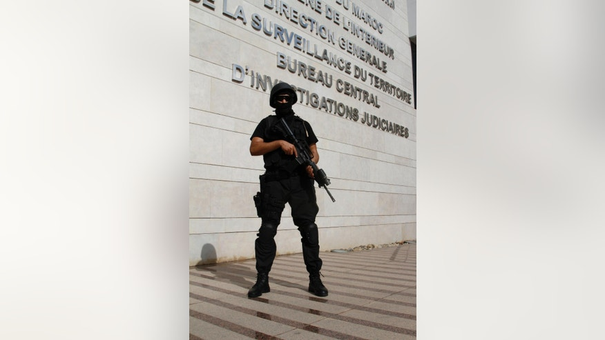 A commando from Morocco's Central Bureau of Judicial Investigations stand guard on Monday Sept. 14, 2015 in Sale, Morocco. Morocco's counter-terrorism unit has announced the dismantling of a militant cell based in the southern city of Essaouira that was in contact with the Islamic State group (AP Photo/Paul Schemm).