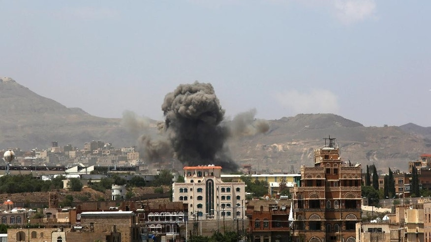 Smoke rises after a Saudi-led airstrike hits an army base in Sanaa, Yemen, Monday, Sept. 14, 2015. Saudi Arabia is leading a coalition of mainly Gulf nations fighting Shiite Yemeni rebels known as the Houthis, who are allied with army units loyal to former President Ali Abdullah Saleh. (AP Photo/Hani Mohammed)