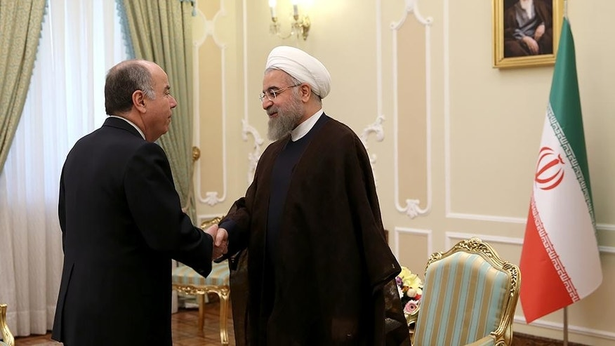 In this photo released by the official website of the office of the Iranian Presidency on Sunday, Sept. 13, 2015, Iran's President Hassan Rouhani, right, greets Brazilian Foreign Minister Mauro Luiz Iecker Vieira at the start of their meeting in Tehran, Iran. (Iranian Presidency Office via AP)