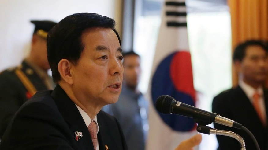 South Korean Defense Minister Han Min-koo answers questions from the media following his meeting with Philippine defense officials and the military leadership Monday, Sept. 14, 2015 at Camp Aguinaldo at suburban Quezon city, northeast of Manila, Philippines. Han is in the country for talked about regional security issues. (AP Photo/Bullit Marquez)