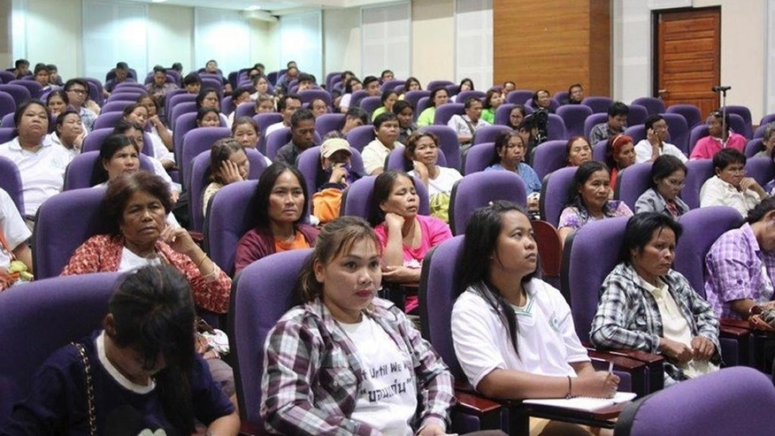 In this May 27, 2015, image provided by Chainarong Sretthachau, villagers affected by gas drilling operated by American company APICO and its subsidiary Tatex Thailand attend a forum at Mahasarakham University, in Maha Sarakham province, Thailand. More than 200 residents in communities near well sites have complained to Thailand's National Human Rights Commission about skin and respiratory problems and some have been hospitalized, according to commission member Dr. Nirun Pitakwatchara. Rubber trees and rice plantations have also been damaged by associated airborne chemicals such as sulfur dioxide and hydrogen sulfide gases, and in one village near a gas operation, locals said their water became brown and unusable. (Chainarong Sretthachau via AP)