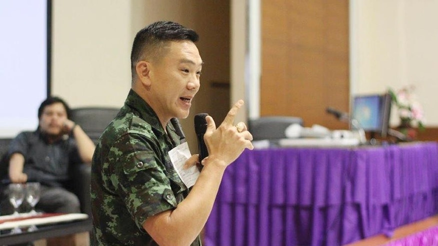 In this May 27, 2015, image provided by Chainarong Sretthachau, Thai Army Lt. Col. Napasit Pongwarapisarn, the provincial military chief of staff, speaks to villagers affected by gas drilling operated by American company APICO and its subsidiary Tatex Thailand at a forum at Mahasarakham University, in Maha Sarakham province, Thailand. More than 200 residents in communities near well sites have complained to Thailand's National Human Rights Commission about skin and respiratory problems and some have been hospitalized, according to commission member Dr. Nirun Pitakwatchara. Rubber trees and rice plantations have also been damaged by associated airborne chemicals such as sulfur dioxide and hydrogen sulfide gases, and in one village near a gas operation, locals said their water became brown and unusable. (Chainarong Sretthachau via AP)