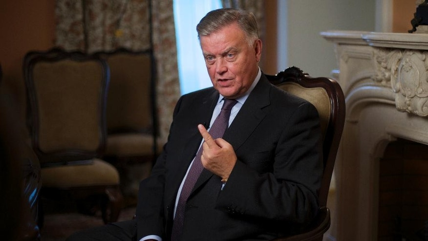 Former Russia's railways chief Vladimir Yakunin speaks during his interview to the Associated Press in Moscow, Russia, on Monday, Sept. 14, 2015. Yakunin a close associate of Vladimir Putin, who recently lost his job, said that the nation's economic downturn will last at least two more years amid continuing Western sanctions. (AP Photo/Ivan Sekretarev)