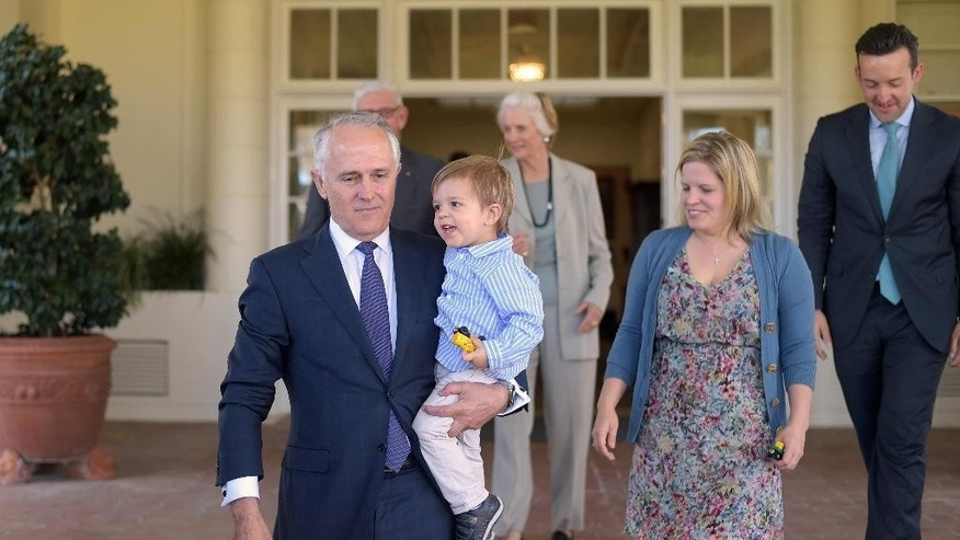 Australian Prime Minister Malcolm Turnbull, left, holds his grandson Jack Turnbull Brown as his family gathers for a photograph at Government House in Canberra, Tuesday, Sept. 15, 2015. Turnbull was sworn in as Australia's 29th prime minister after a surprise ballot of his conservative Liberal Party colleagues voted 54-44 on Monday night to replace Prime Minister Tony Abbott only two years after he was elected. (Lukas Coch/Pool Photo via AP)