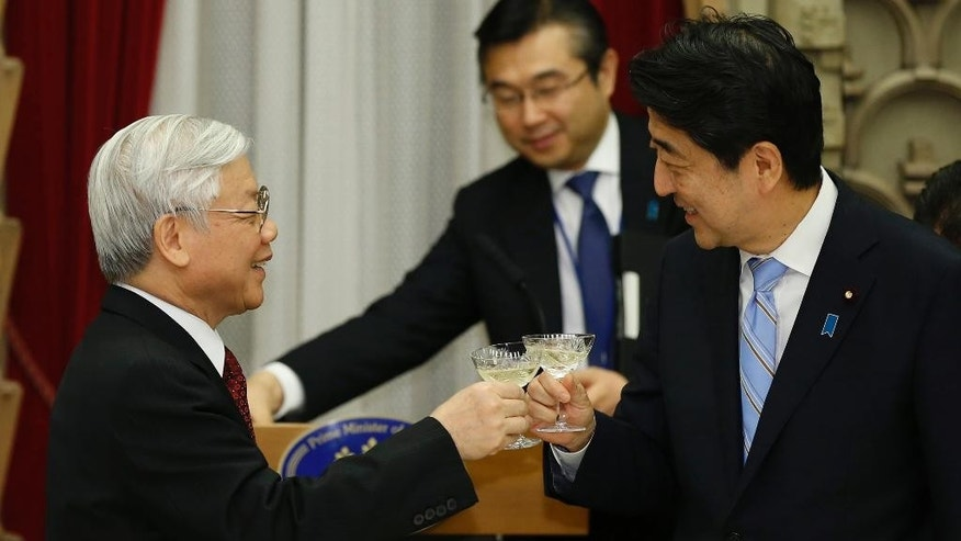 Vietnam's Communist Party General Secretary Nguyen Phu Trong, left, and Japan's Prime Minister Shinzo Abe make a toast during a welcome dinner hosted by Abe at Abe's official residence in Tokyo Tuesday, Sept. 15, 2015. (Toru Hanai/Pool Photo via AP)