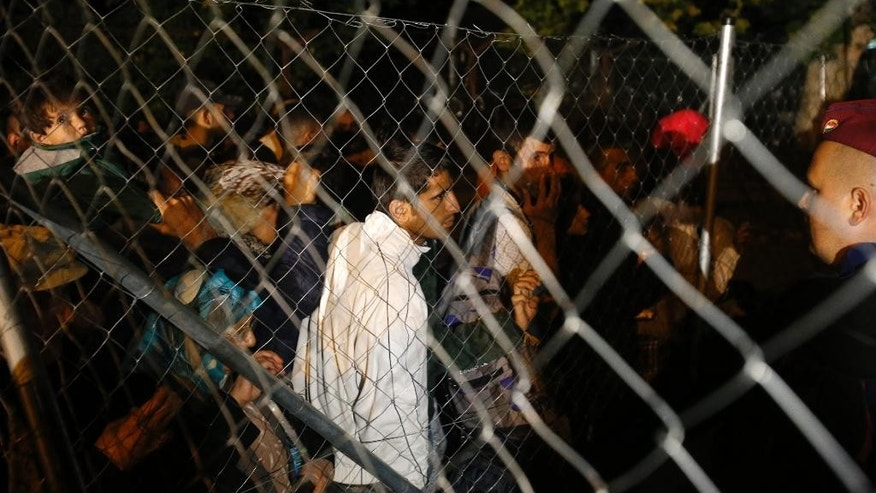 "Migrants enter Hungary at the ""Horgos 2"" border crossing, near Horgos, Serbia, Monday, Sept. 14, 2015. Migrants at Hungary's crowded border crossings with Austria and Serbia faced fear and uncertainty Monday, as several European Union countries beefed up border controls in a precedent that could gut the bloc's cherished principle of free movement among most of its nations. (AP Photo/Darko Vojinovic)"