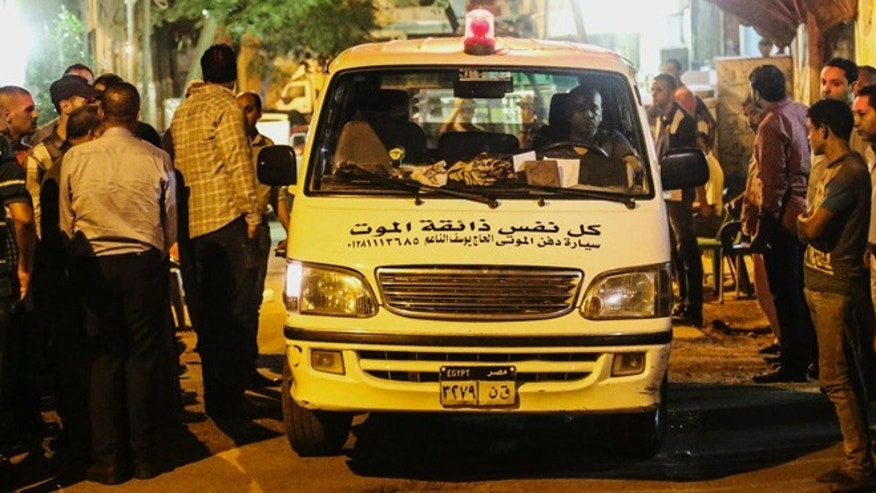 Sept. 14: A funeral vehicle carrying an Egyptian victim of Sunday's incident in which Egyptian forces mistakenly opened fire on tourists in the western desert, arrives at a morgue in Cairo.