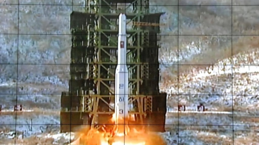 FILE - In this Dec. 12, 2012 file photo, a screen at the General Satellite Control and Command Center shows the moment North Korea's Unha-3 rocket is launched in Pyongyang, North Korea. North Korea said Monday, Sept. 14, 2015 it is ready to launch satellites aboard long-range rockets to mark a key national anniversary next month, a move expected to rekindle animosities with its rivals South Korea and the United States. North Korea has spent decades trying to perfect a multistage, long-range rocket. After several failures, it put its first satellite into space with a long-range rocket launched in late 2012. (AP Photo/File)