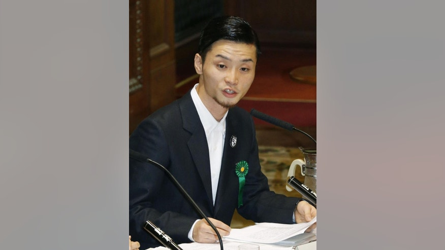 In this Sept. 15, 2015 photo, Aki Okuda, a leader of the student group known as SEALDs, or Students Emergency Action for Liberal Democracies, speaks during a hearing at the committee on the security legislation in the parliament's upper house in Tokyo. Opposition lawmakers and thousands of demonstrators were making last-ditch protests in a political showdown Wednesday as Japan's ruling party started a final push to pass security legislation to expand the role of the country's military.   (Kyodo News via AP) JAPAN OUT, MANDATORY CREDIT