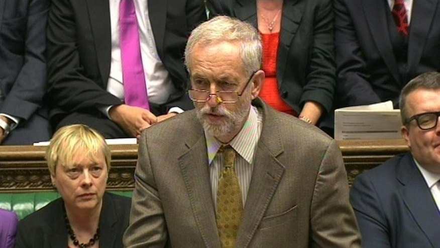 "The leader of Britain's opposition Labour party Jeremy Corbyn speaks during Prime Minister's Questions in the House of Commons, London, Wednesday Sept. 16, 2015. The ""prime minister's questions"" session will give many Britons their first extended look at the veteran left-winger who became the Labour Party leader Saturday after a months-long campaign. (PA via AP) UNITED KINGDOM OUT  NO SALES  NO ARCHIVE"