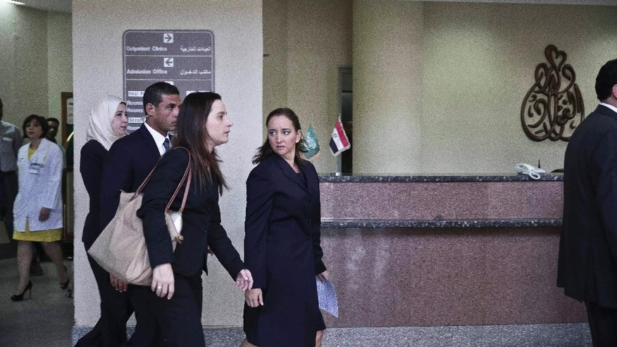 Secretary of Foreign Relations Claudia Ruiz Massieu, center, arrives to speak to the media after her visit to injured Mexican tourists at the Dar Al Fouad Hospital in Cairo, Egypt, Wednesday, Sept. 16, 2015. Massieu is in Cairo after Egyptian security forces mistakenly killed at least eight Mexican tourists on a desert safari. (AP Photo/Nariman El-Mofty)