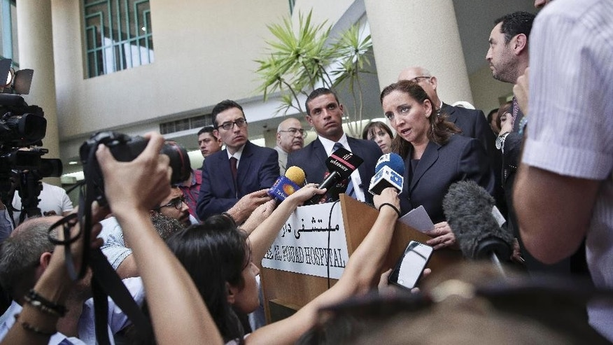 Mexico's Secretary of Foreign Relations Claudia Ruiz Massieu speaks to journalists after her visit to injured Mexican tourists at the Dar Al Fouad Hospital in Cairo, Egypt, Wednesday, Sept. 16, 2015. Massieu is in Cairo after Egyptian security forces mistakenly killed at least eight Mexican tourists on a desert safari. (AP Photo/Nariman El-Mofty)