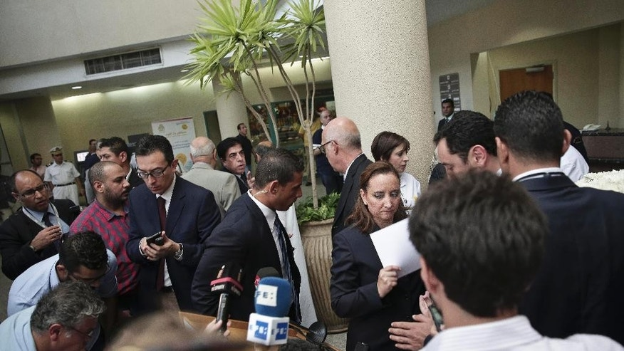 Mexico's Secretary of Foreign Relations Claudia Ruiz Massieu leaves after briefing journalists injured Mexican tourists at the Dar Al Fouad Hospital in Cairo, Egypt, Wednesday, Sept. 16, 2015. Massieu is in Cairo after Egyptian security forces mistakenly killed at least eight Mexican tourists on a desert safari. (AP Photo/Nariman El-Mofty)