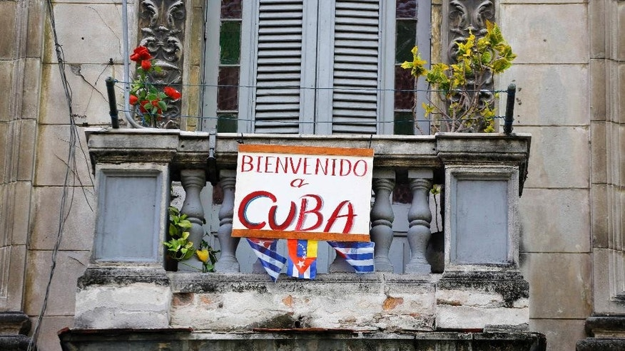 A poster with a welcome message directed at Pope Francis decorates a balcony in Havana, Cuba, Tuesday, Sept. 15, 2015. Francis will visit Cuba from Sept. 19-22, before arriving in the United States, making him the third pontiff to visit the island nation. (AP Photo/Desmond Boylan)