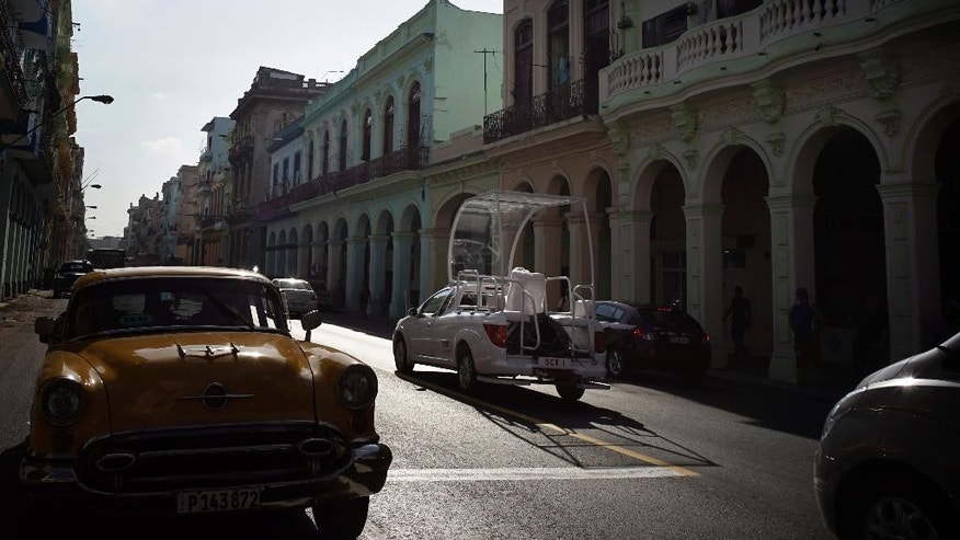 The Popemobile is taken for a test drive through the streets of Havana, Cuba, Monday, Sept. 14, 2015. Pope Francis will visit Cuba from Sept. 19-22 , before arriving in the United States, making him the third pontiff to visit the island nation. (AP Photo/Ramon Espinosa)