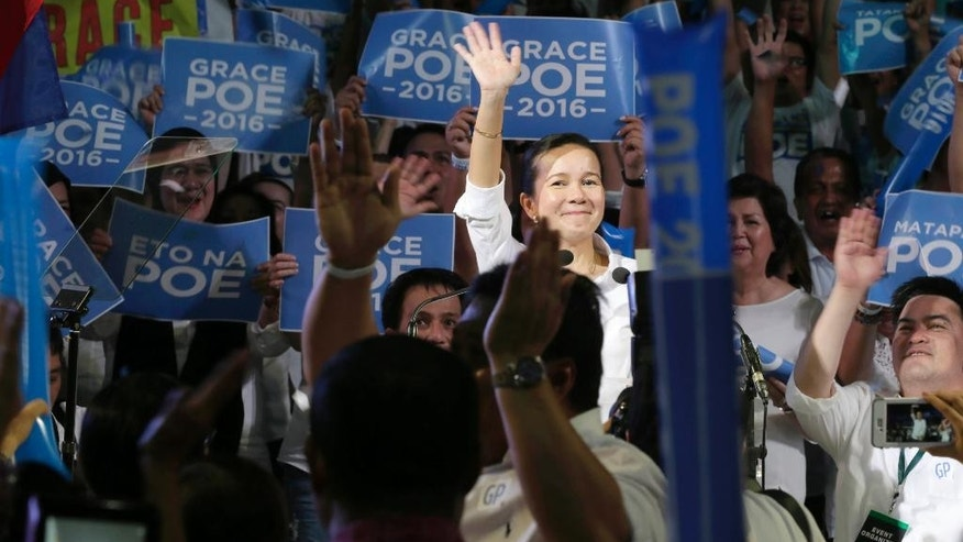 Sen. Grace Poe acknowledges her supporters shortly after announcing her intention to run for the 2016 presidential elections Wednesday, Sept. 16, 2015 at the alumni hall of the country's premier university, the University of the Philippines at suburban Quezon city, northeast of Manila, Philippines. Poe topped the senatorial race in the local elections three years ago. (AP Photo/Bullit Marquez)
