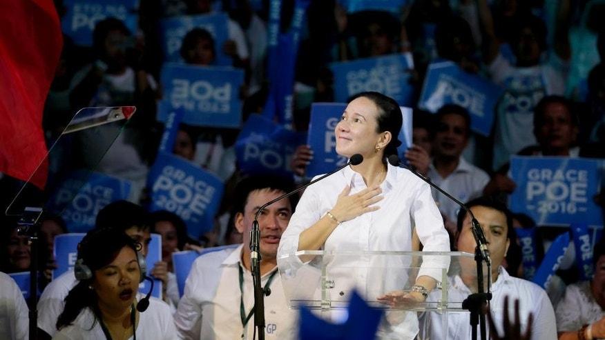 Sen. Grace Poe acknowledges her supporters shortly after announcing her intention to run for the 2016 presidential elections Wednesday, Sept. 16, 2015 at the alumni hall of the country's premier university, the University of the Philippines, at suburban Quezon city, northeast of Manila, Philippines. Poe topped the senatorial race in the local elections in 2013. (AP Photo/Bullit Marquez)