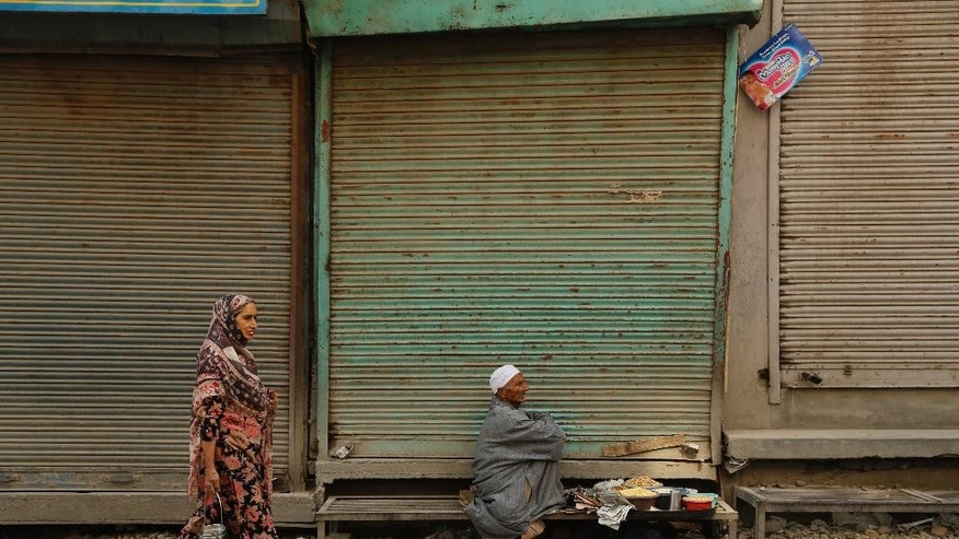 A Kashmiri snacks vender sits at a closed market awaiting customers during a strike in Srinagar, Indian controlled Kashmir, Wednesday, Sept. 16, 2015. Kashmiri separatists called for a complete shutdown across Kashmir on Wednesday, to protest the recent killings of three young men by unknown gunmen in north kashmir. (AP Photo/Mukhtar Khan)
