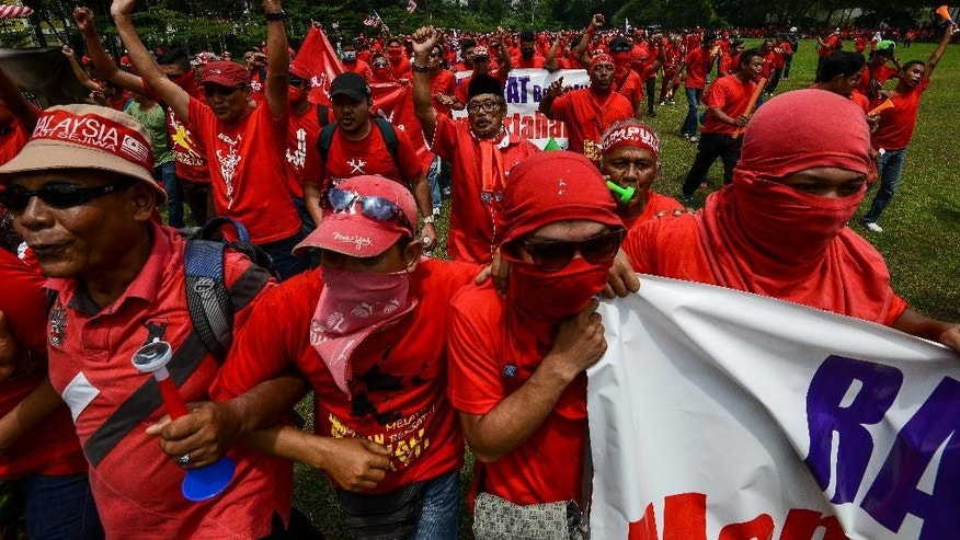 Pro-government 'red shirt' protestors stage a pro-government rally in Kuala Lumpur, Malaysia on Wednesday, Sept. 16, 2015. Thousands of ethnic Malays in red shirts held a rally Wednesday to uphold Malay dominance and support Malaysian Prime Minister Najib Razak's government, following calls for Najib to step down over a $700 million financial scandal. (AP Photo/Osman Hassan)