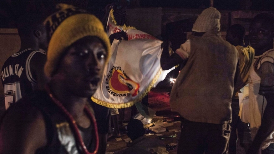 Sept. 16, 2015: People demonstrate near the presidential palace after soldiers arrested Burkina Faso's transitional president and prime minister in Ouagadougou, Burkina Faso.